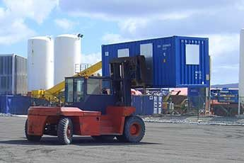 Moving a converted shipping container using a forklift